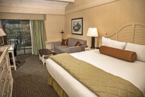 A bed or beds in a room at The Abbey Resort