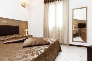 A bed or beds in a room at Le Residenze del Centro