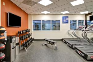 The fitness center and/or fitness facilities at Hampton Inn & Suites by Hilton Calgary-Airport