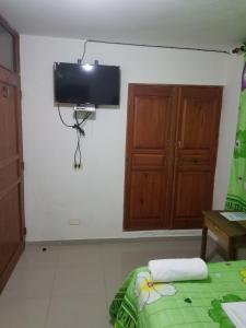 A television and/or entertainment center at Hostel Quintonido