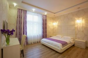 A bed or beds in a room at Lviv Apartments