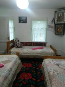 A bed or beds in a room at Dykyi Khutir