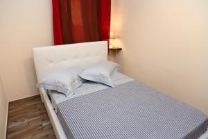 A bed or beds in a room at Campeggio Sanfilippo