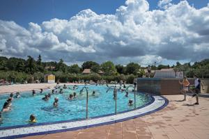 The swimming pool at or near Holiday Centre Bi village