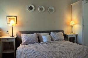 Łóżko lub łóżka w pokoju w obiekcie Apartament Margarita