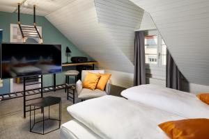 Телевизор и/или развлекательный центр в Hotel Restaurant Stern Luzern