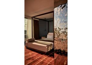 A bed or beds in a room at Sir Joan Hotel