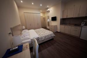 Кровать или кровати в номере Мини-отель Игрок