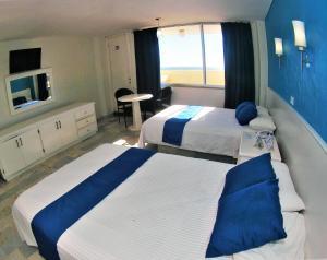 Cama o camas de una habitación en Hacienda Mazatlán sea view