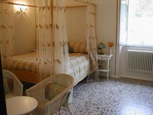 Letto o letti in una camera di Villa Rosalena
