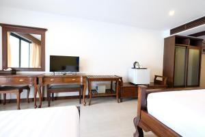 A bed or beds in a room at Wongamat Privacy Residence, Pattaya