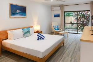 A bed or beds in a room at Uyoung Diving Resort