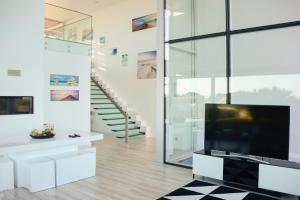 A television and/or entertainment center at Palmares Beach, Golf & Dream
