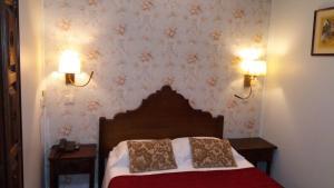 Een bed of bedden in een kamer bij Hotel Dom Sancho I