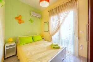 Łóżko lub łóżka w pokoju w obiekcie 2 Bedrooms apartment with pool in Filerimos