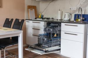 Kuchyň nebo kuchyňský kout v ubytování Eliška