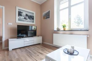 TV a/nebo společenská místnost v ubytování Eliška