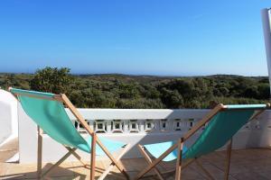 A balcony or terrace at Trivial Pisão - Casa de Férias, para a sua Família