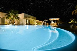 The swimming pool at or near Queen Boutique Suites