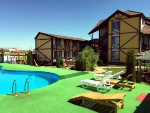 The swimming pool at or near DelMare Guest House