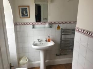 A bathroom at Winston Manor Hotel