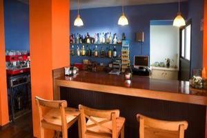 El salón o zona de bar de Hotel Villa El Mocanal