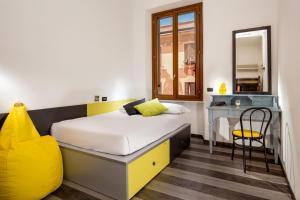 Un ou plusieurs lits dans un hébergement de l'établissement Free Hostels Roma