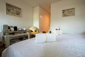 A bed or beds in a room at In Casa