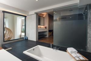 Ein Badezimmer in der Unterkunft Idyllic Concept Resort