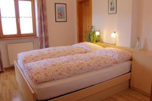 Ein Bett oder Betten in einem Zimmer der Unterkunft Spisserhof