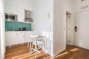 A cozinha ou cozinha compacta de Dream Chiado Apartments
