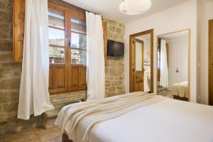 Cama o camas de una habitación en Posada de Uncastillo