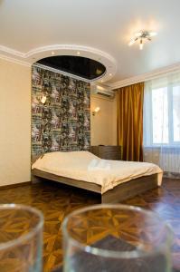 Кровать или кровати в номере Апартаменты ЖК Акварель