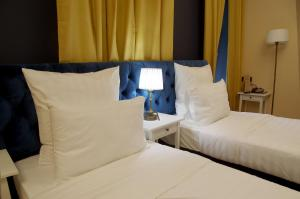 A bed or beds in a room at Barin Residence Centre