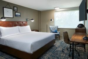 A bed or beds in a room at Four Points by Sheraton Toronto Airport