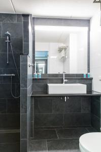 Een badkamer bij Bastion Hotel Amsterdam Amstel