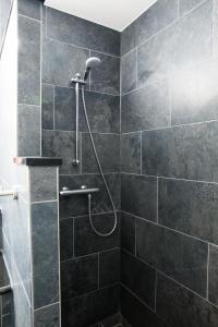 Een badkamer bij Best Western Plus Amsterdam Airport Hotel