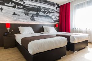 A bed or beds in a room at Best Western Plus Amsterdam Airport Hotel
