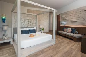 Ein Bett oder Betten in einem Zimmer der Unterkunft Idyllic Concept Resort
