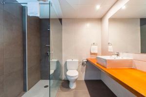 Ванная комната в Hotel Ridomar