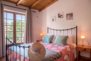 Cama o camas de una habitación en Casinha D'Avó Guesthouse