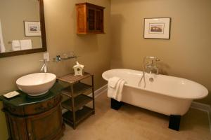 A bathroom at Water's Edge Inn - Adults Only