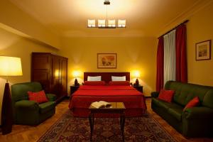 A bed or beds in a room at Pao de Acucar Hotel
