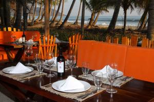 A restaurant or other place to eat at Hotel Tropico Latino