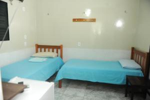 A bed or beds in a room at Hotel Bem Vindo