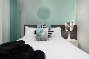A bed or beds in a room at QT Falls Creek