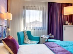 Un ou plusieurs lits dans un hébergement de l'établissement Mercure Marseille Centre Vieux Port
