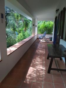 A balcony or terrace at B&B S'Archiotta