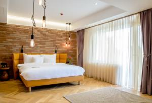 A bed or beds in a room at Caro Hotel