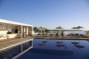 The swimming pool at or near Memmo Baleeira - Design Hotels